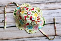 Come check out this adorable DIY Free Tulip Petal Sun Hat Girls Sewing Pattern from The Cottage Mama. www.thecottagemama.com