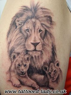 Lion & cubs tattoo close up