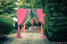 indian-wedding-mehndi-party-ideas-decor-curtains-bright-colors-hot-pink-lime-green-orange