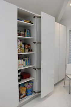 Full height pantry storage, low profile with side opening doors- great idea for nyc apartment design