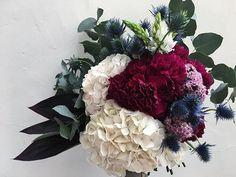 Pretty blooms for a pretty lady @madwilson_⠀⠀⠀⠀⠀⠀⠀⠀⠀ ⠀⠀⠀⠀⠀⠀⠀⠀⠀ #flowers #blooms #florist #weddingflowers #flowerdesign #floraldesign #flowersofinstagram #wedding  #bouquet #weddingbouqet #greenery  #moodygrams #colour #magenta #burgundy #texture #weddinginspiration #weddinginspirations #weddinginspo #weddingideas #weddingseason  #hydrangeas #carnations #seaholly  #pinktones #weddingplanner  #flowerarranging #rubyandjames #snapseed #bridal