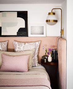 Intriguing wrap around upholstered headboard with corner bedside shelf