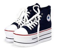 Image from http://i00.i.aliimg.com/wsphoto/v0/536708466_2/NEW-Women-s-Wings-Cool-high-heel-Platform-Sneakers-shoes-2.jpg.