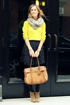 Show off your playful side in a yellow crew-neck sweater and a black and white polka dot pleated skirt. Why not introduce tan suede ankle boots to the mix for an added touch of style?  Shop this look for $107:  http://lookastic.com/women/looks/scarf-crew-neck-sweater-skater-skirt-bracelet-satchel-bag-tights-ankle-boots/4573  — Grey Scarf  — Yellow Crew-neck Sweater  — Black and White Polka Dot Skater Skirt  — Gold Bracelet  — Tan Leather Satchel Bag  — Black Wool Tights  — Tan Suede Ankle…