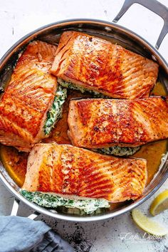 Creamy Spinach Stuffed Salmon in garlic butter is a new delicious way to enjoy salmon! Filled with cream cheese, spinach, parmesan cheese and garlic, this salmon beats than anything found in a restaurant. Your new favourite salmon recipe includes pan fried AND oven baked methods!   cafedelites.com