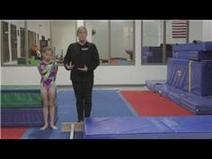 Gymnastics Tips and Exercises : How to Teach a Cast Handstand on the Bars in Gymnastics