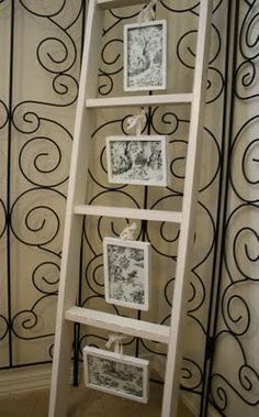 Transforming an old bunk bed ladder into a picture gallery. How cute is that? I have an old ladder I need to get creative with!