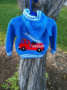 Hand knit child's hooded fire truck sweater by threeknitters, $60.00