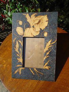 Pretty Arts & Crafts glazed poker work photo frame adorned with poppies and buds. Antiques Atlas