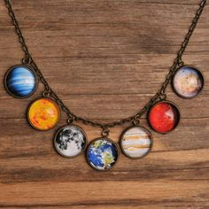 Our beautiful Solar System Necklace is an out of this world accessory for any outfit! It holds infinite possibilities for making a Big Bang at your next social gathering! You'll appreciate how colorful and unique this conversation piece is!  Remember going on field trips to the planetarium in elementary school? We sure do, that's where our love of space first began!  A stellar gift for the avid astronomer, fashionista, or your nostalgic inner child from grade school!  Shine on and let the…