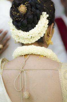 South Indian bride. Temple jewelry. Jhumkis.White silk kanchipuram sari.Bun with fresh jasmine flowers. Tamil bride. Telugu bride. Kannada bride. Hindu bride. Malayalee bride.Kerala bride.South Indian wedding.