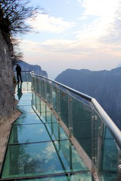 A glass walkway attached to a mountain almost a mile in the air (4700 feet!)    Tianmen Mountain, China