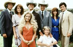 Original Dallas - Linda Gray, Larry Hagman (2nd & 3rd from left), and Patrick Duffy (right) with the original cast. (Everett)