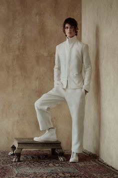Alexander McQueenpresented itsSpring/Summer 2017 collection through photography and imagery this season. The journey of the collection begins in 1960s swinging London and moves to a dusty exotic world. Traditional, sharply cut Savile Row tailoring in sober shades gradually... »