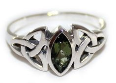This stunning Sterling Silver ring features a faceted Moldavite marquise in a Celtic triquetra design. The ring is available in sizes 4 through 12 and is stamped 925 on the inside of the band. This ring is the perfect gift for birthdays and anniversaries or just to surprise your loved one. #Moldavite