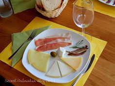 Pag Cheese,  You'll most likely find it as an appetizer, served with olives on the side.