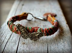 Batik Fabric Wrapped Leather Bracelet with Pewter Hook, Etched Shell and Pewter butterfly focal
