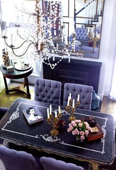 Gray tuft dinning chairs, vintage distressed table, fireplace, chandelier