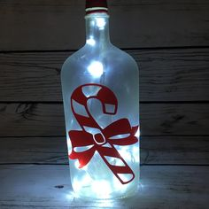 Your stockpile of empty wine bottles is steadily growing? Then now is a good time as any to transform them into something pretty with these wine bottle crafts with lights. Liquor Bottle Crafts, Empty Wine Bottles, Wine Bottle Corks, Painted Wine Bottles, Lighted Wine Bottles, Bottle Lights, Reuse Bottles, Wine Glass, Liquor Bottles