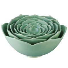 Sharing a similar resemblance to structures of a lotus flower, these 'Nesting Lotus Bowls' designed by ceramist Whitney Smith features eight bowls that'll come in handy for small and large gatherings alike. Blossoming with natural, sculpted beauty, these fabulous ceramic bowls will stand as a beautiful timepiece on your countertop whenever unused.