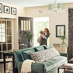 Gray & Turquoise Living Room with Black Door and Chandelier