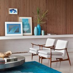 Jorge Zalszupin´s Dinamarquesaarmchairs, designed in 1952. The Dinamarquesa takes cues from Danish mid-century modern furniture design (dinamarquesa meaning Danish in Portuguese), while creating one of the best examples of Brazilian Modern style furniture. / Pinterest