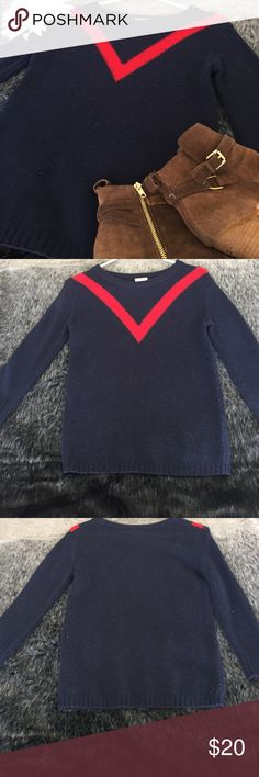 JCRew Crew neck sweater Keep it Nautical 🚤 in this Navy blue with red v-stripe sweater from j crew. Sweater has slight pilling which is normal for sweaters of this material. I will remove pilling upon purchase. Size is xxs but it runs big and would be fine for an xs or s. J. Crew Sweaters Crew & Scoop Necks