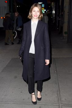 Sophia Coppola's street-style look. Black pants and a cozy sweater become a sophisticated ensemble with that killer jacket, simple hair and makeup, and basic heels.