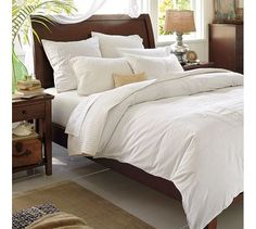 Sleigh bed and white bedding.