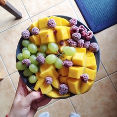 Fruit bowl! Mango, frozen raspberries, and green grapes