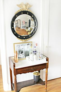 Vintage marble wash stand turned bar with a Federal eagle mirror. Love this! via Burlap and Lace