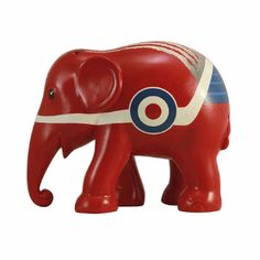 Elephant Parade 10cm Red Arrow Elephant Decor: 10cm Red Arrow elephant decor. All Elephant Parade replica elephants are part of an exclusive limited edition. Each elephant will be delivered with a hologram of authenticity as well as a certificate listing the design name, artist, production number and series, year, and parade city. All replica elephants are hand-painted at the Elephant Parade studio in Chiang Mai, Thailand.