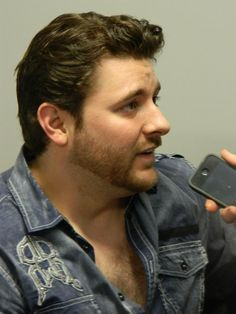 AGAIN ~ Is he trying to kill us with that shirt ;) LOL <3 Chris Young being interviewed by The Range in Australia