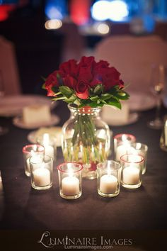Red rose centerpiece with candles