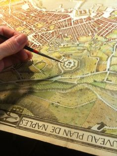 geocrusader80: Art: drafting a cartographic map of Naples, Italy.