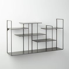 Sculptural, industrial grid of five shelves and one ledge compose a graphic gallery in raw steel. Displays objects, books, wine, candles—all your favorite things. Hang alone or double up for extra drama. Shop Storage, Storage Boxes, Storage Shelves, Metal Shelves, Wall Shelves, Shelf, Fuel Juice Bar, Concrete Interiors, Modern Shelving