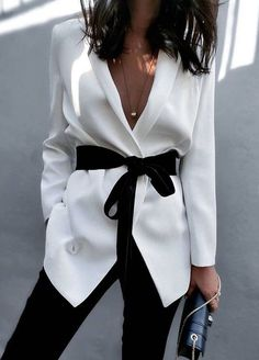 White waterfall type jacket with black sash and black trousers. Really chic and flattering