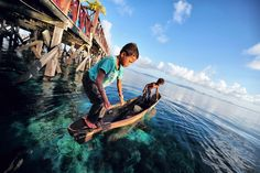 Traditional Fishing at Mabul Island in Semporna, Sabah.  The coral studded water looks gorgeous.