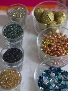 Items such as sequins, beads, stamps, pins, glitter and bells look great in small round bowls. Plus, it keeps them accessible for everyone.