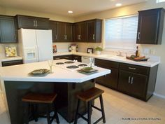 """Oak Cabinets?  Update them with paint! Click to see the """"before"""" and the instructions."""