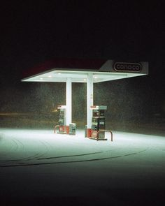 This photo makes great use of the contrasts between light and dark. It is clearly late at night, as everything is pitch black, and then the gas station lights provide a stark contrast with their brightness. Apocalypse Aesthetic, Photocollage, Weird Dreams, Night Aesthetic, Night Photography, Aesthetic Pictures, Nostalgia, Scenery, Lights