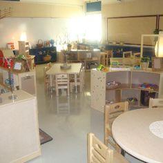 Reggio Emilia classroom setup. I love the tiny circular mirrors on the shelf.
