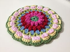 Bobbly Flower transformed into Mandala! Done in simple and basic crochet stitches, the pattern should work up fairly quickly.