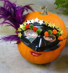 picture from a mag behind the mask for the eyes and mouth glued to the pumpkin before the decorated mask