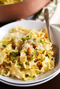 Basic bacon and brussels sprouts pasta carbonara is a take on the classic creamy pasta. It's still got all the flavor but just more ingredients to love!