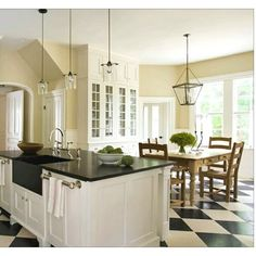 Checker board kitchen floor by pauline.... LOVE this!! Black and white kitchen!! Yes please!!