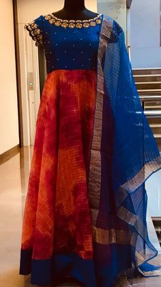 Beautiful blue and red color combination floor length dress with floral design hand embroidery gold thread work on neckline. Price : 7000 INR To order whatsapp Salwar Designs, Kurta Designs Women, Kurti Designs Party Wear, Blouse Designs, Dress Designs, Designer Anarkali Dresses, Designer Party Wear Dresses, Indian Designer Outfits, Long Gown Dress
