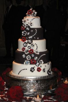 I love the flowers and colors on this cake but wish there wasn't black layers