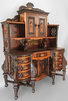 "Unusual Revival Desk    True one of a kind piece with several styles and time periods incorporated. Masterfully crafted throughout, with inlay, relief carvings, applied carvings and a painted center panel.   Purportedly made in St Louis, Mo, c,1890  70 ½"" x 52"" x 22"""