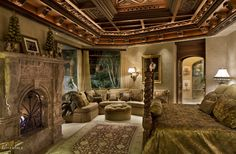 Incredible wood coffered ceiling, and a carved marble mantel...